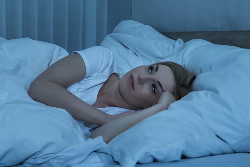 stockfresh_5953111_woman-in-bed-suffering-from-insomnia_sizeXS