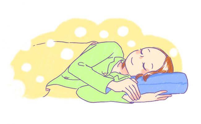 安眠枕で眠る女の子のイラスト