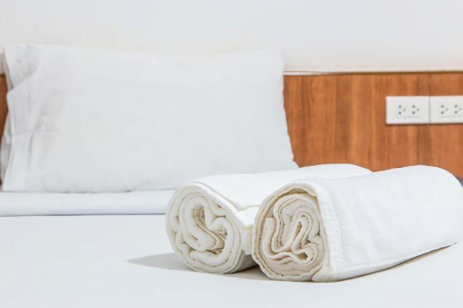 丸めたバスタオルで作った骨盤枕の画像